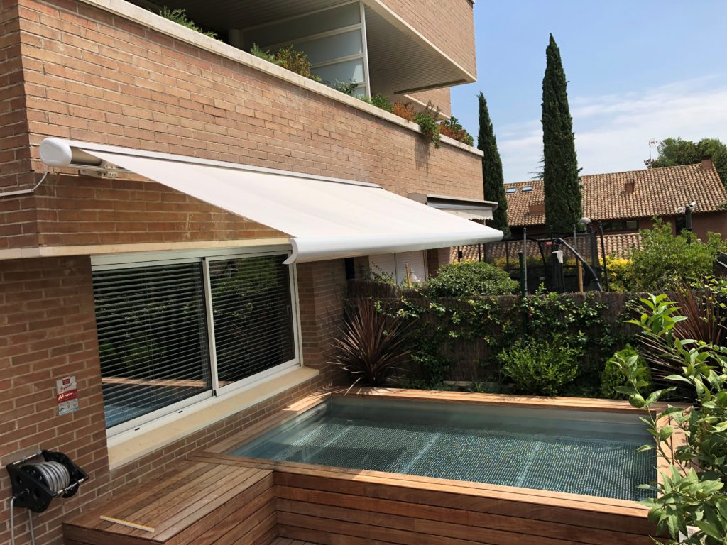 awning covering part of outdoor pool